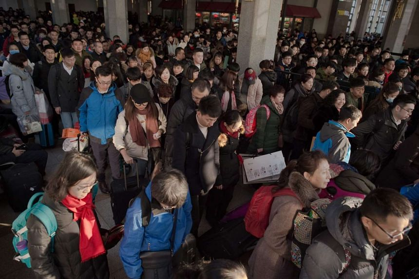 Passengers arriving at the Beijing Railway Station to travel to their home towns for the new year festivities, on Jan 24, 2017.