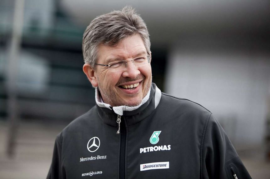 Britain's Ross Brawn, team principal of Mercedes GP smiles as he walks on the paddock at the Shanghai International circuit, in Shanghai, China, on April 15, 2010.
