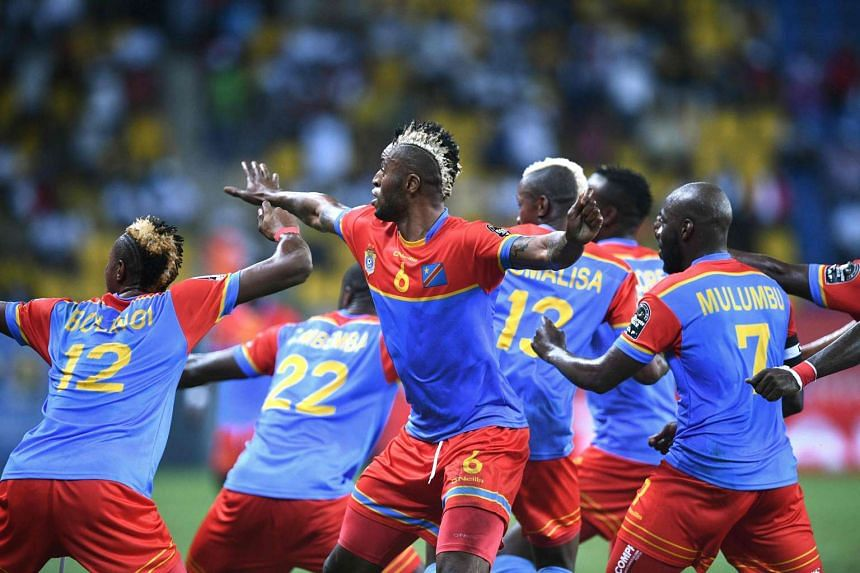 Democratic Republic of the Congo's forward Junior Kabananga (centre) celebrates with teammates after scoring a goal during the 2017 Africa Cup of Nations group C football match between Togo and DR Congo in Port-Gentil on Jan 24, 2017.