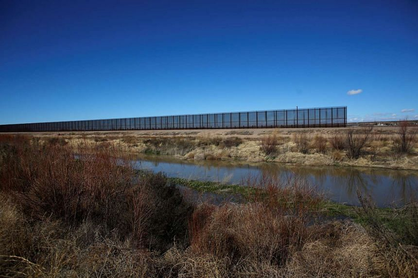 A gap in the Mexico-US border fence is pictured from the municipality of Praxedis G. Guerrero, in the Juarez Valley, Mexico.