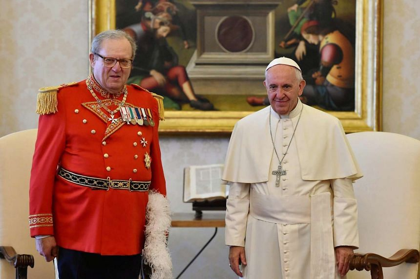 Knights of Malta Grand Master Matthew Festing (left) meeting with Pope Francis on June 23, 2016.