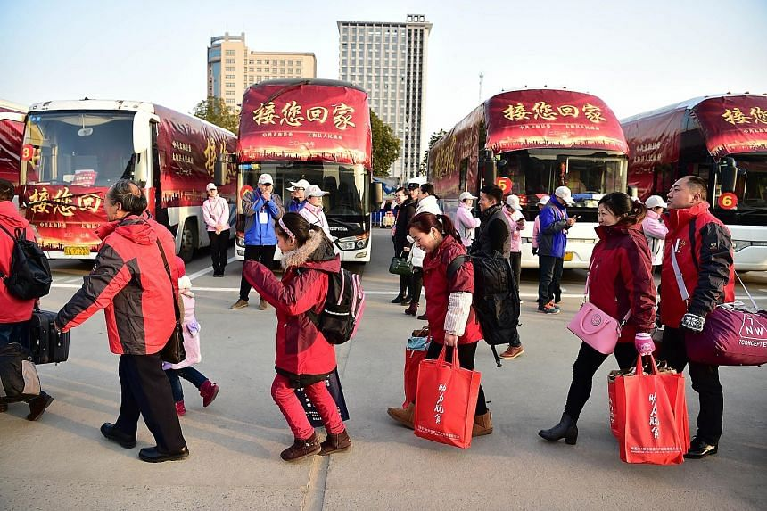 Fuyang city in China's Anhui province providing free transport at Fuyang Railway Station Square last Saturday to take returning migrant workers home for Chinese New Year.