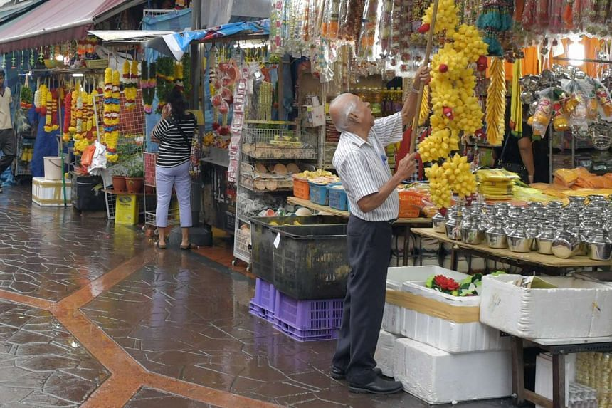 The NHB hopes visitors will walk through Little India's cluttered five-foot ways (above), which are filled with fresh produce, flower garlands and spices.