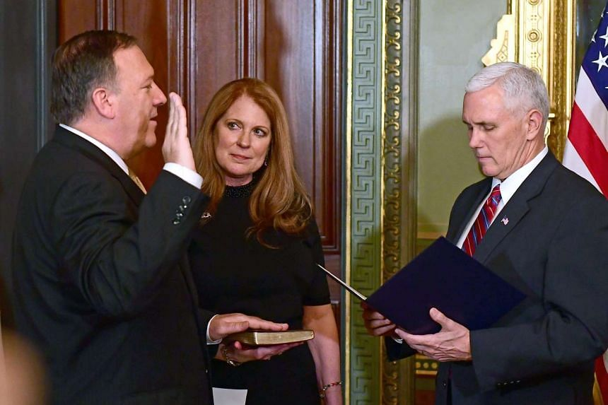 US Representative Mike Pompeo (left), a Republican from Kansas, being sworn in as director of the CIA by Vice-President Mike Pence in Washington on Monday. With them is Mr Pompeo's wife Susan. The CIA is bracing itself for its most contentious relati