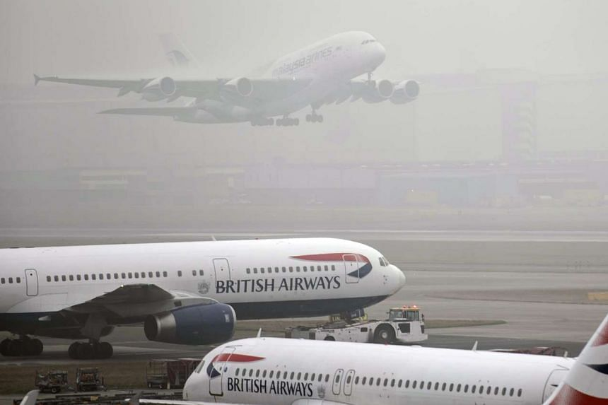 The foggy conditions resulted in at least 100 flights being cancelled at London's Heathrow Airport yesterday.