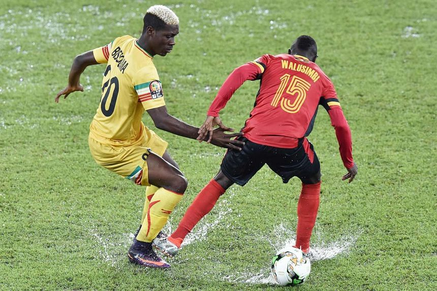 Uganda scored their first goal at an African Nations Cup finals for 39 years as they bowed out of the tournament with a 1-1 draw against Mali.