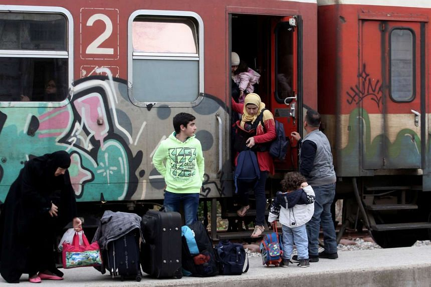 Adan's family members, from the Syrian city of Aleppo, come out of they train as they arrive at the train station of Didymoteicho some 400 km North-East from Thessaloniki near the Greek-Turkish border,on Oct 26, 2016.