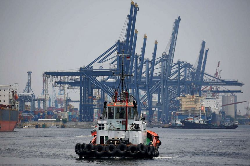 A tug boat is seen near a container port in Tanjung Priok, North Jakarta, Indonesia.
