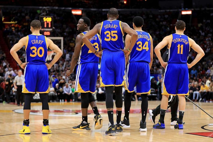 The Golden State Warriors line up during a game against the Miami Heat at American Airlines Arena on Jan 23, 2017, in Miami, Florida.