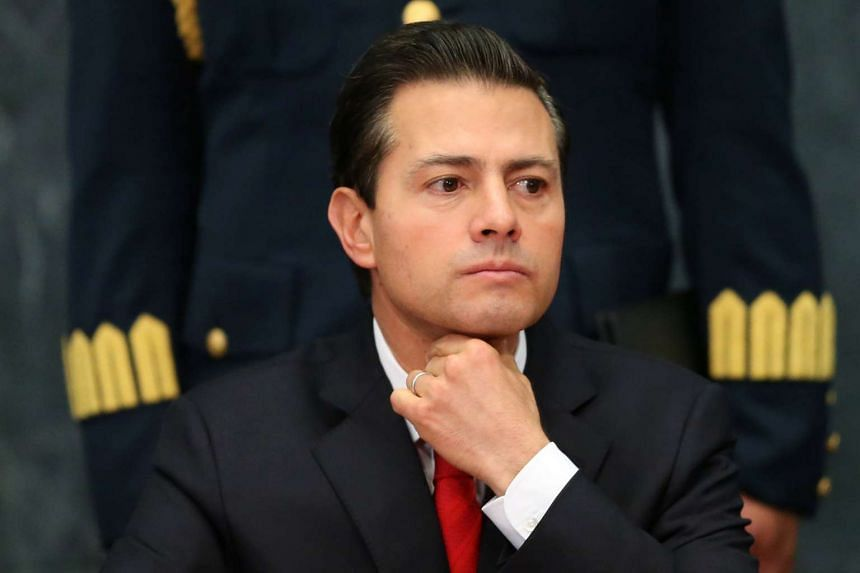 Mexico's President Enrique Pena Nieto gestures as he delivers a message about foreign affairs at Los Pinos presidential residence in Mexico City on Jan 23, 2017.
