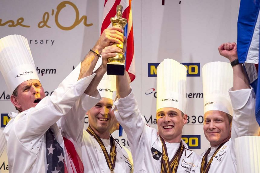 Chef Mathew Peters (2nd left) from USA celebrate with team mate and Chef Thomas Keller (left) after winning the Bocuse d'Or during the second day competition of the two-day world final of the Bocuse d'Or contest at the Sirha International Hotel Cater
