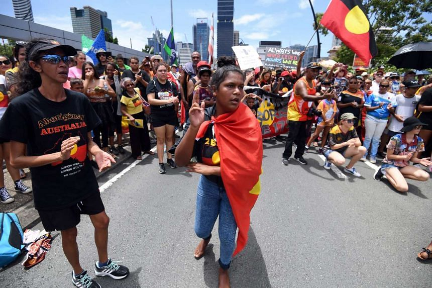 Indigenous protesters marching through central Brisbane in an 'Invasion Day' protest march on Australia Day, on Jan 26, 2017.