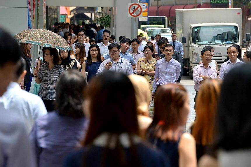 The office crowd in the Central Business District (CBD) of Singapore.