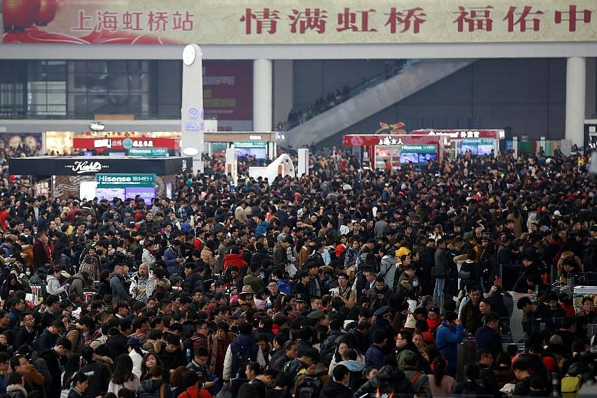 Passengers waiting to board trains at Shanghai's Hongqiao Railway Station yesterday. Although hundreds of millions of workers will return to their hometowns, outbound travel for the holiday break is expected to top a record six million passengers, wi