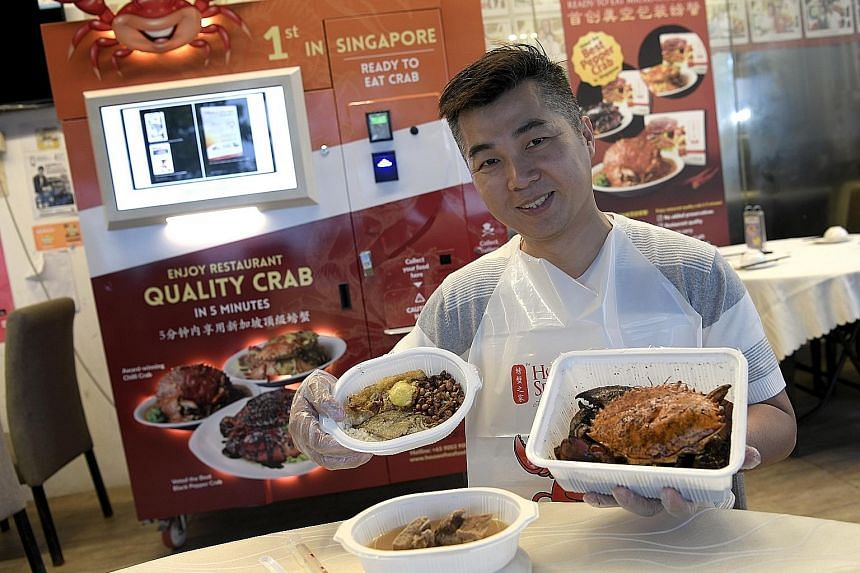 House of Seafood owner Francis Ng with the offerings from his vending machine - nasi lemak, black pepper crab and bak kut teh.