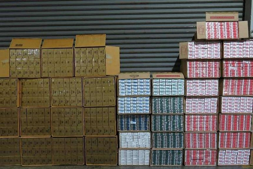 Singapore Customs seized 20,600 cartons of duty-unpaid cigarettes in an operation in Pioneer Sector 3 on Monday.