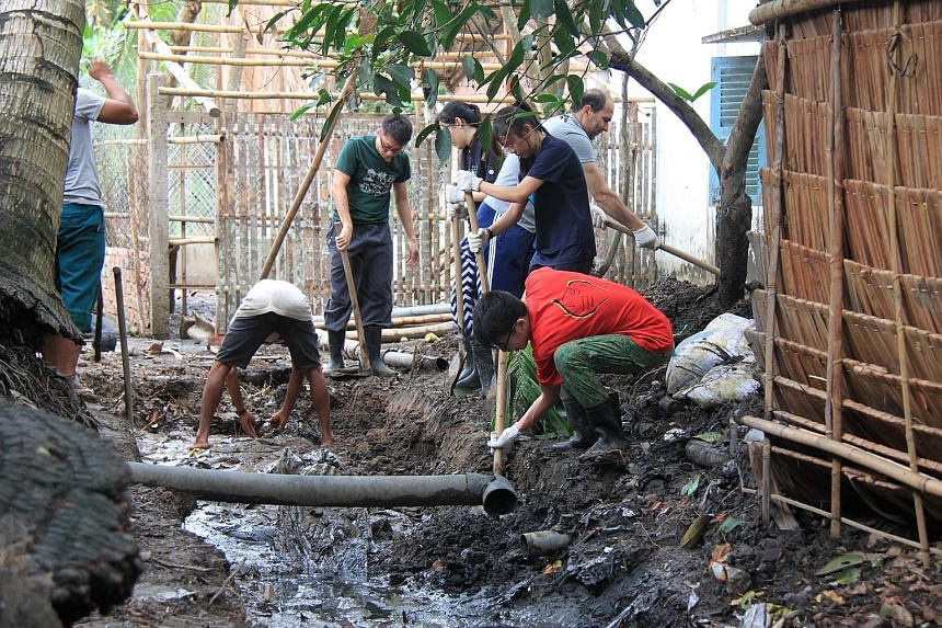 NTU students on Project Mai, in Vietnam, which involved building biogas systems to convert pig waste to methane, which can be used as cooking gas.