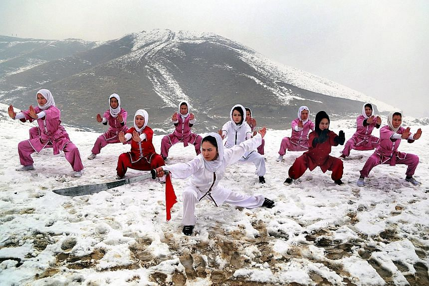 Afghan girls from the Shaolin Wushu Club practising their skills during a training session on the top of a hill in Kabul, Afghanistan, yesterday. There are 20 girls, whose ages are from 14 to 20 years, learning wushu in the club. The Afghan girls hav