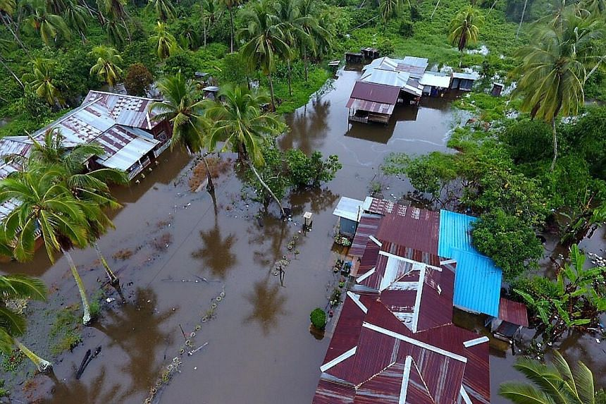 Flooded roads in Segamat, Johor. The state, which was the worst hit, faces more thunderstorms over the Chinese New Year weekend. Floodwaters hit houses in a Perak village as three days of relentless rain in Malaysia brought floods to nine of the coun