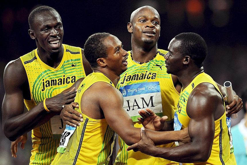 The Jamaica 4x100m relay team celebrating at the 2008 Beijing Olympics. They have been officially stripped of their gold medals after Nesta Carter (right) was found guilty of a doping violation. The medals will now go to the Trinidad and Tobago 4x100