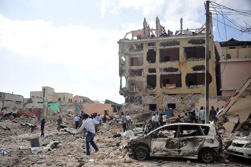 Two car bombs exploded outside a popular Mogadishu hotel and gunmen opened fire inside the building. The attack, claimed by Islamist group Al Shabaab, began when a car loaded with explosives rammed the gate of the Dayah Hotel, and a second blast shor