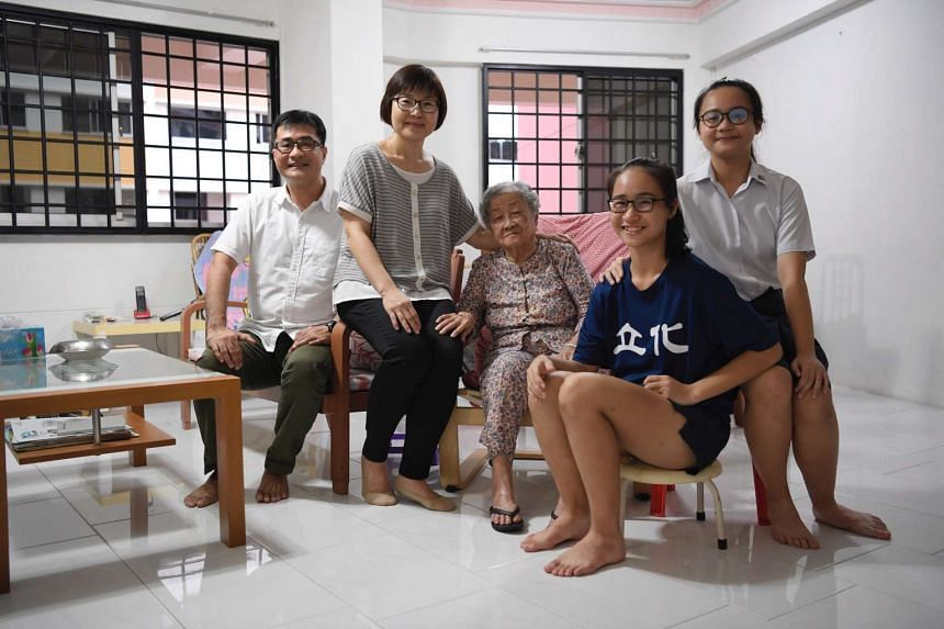 (From left) Mr Tan Chow Hua, 49, Mdm Woon Chay Lee, 48, Mdm Loh Khim, 86, Tan Si Min, 15 and Tan Si Qi, 17, in their Jurong West flat. Mr Tan and his wife applied for a 3gen flat in Boon Lay View and have just received their keys to their new home.
