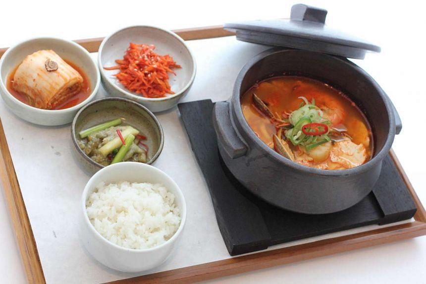 Sun Du Bu Jji Gae set comprises of Korean soft tofu soup, assorted seafood, and half-moon rice cake with sesame or chestnut fillings.