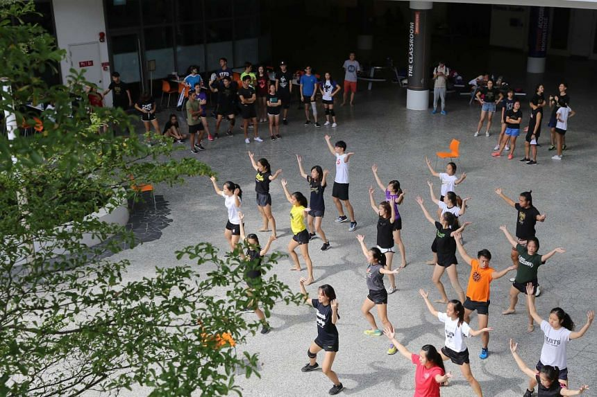 Students practising dance moves for the NUS Rag and Flag day.