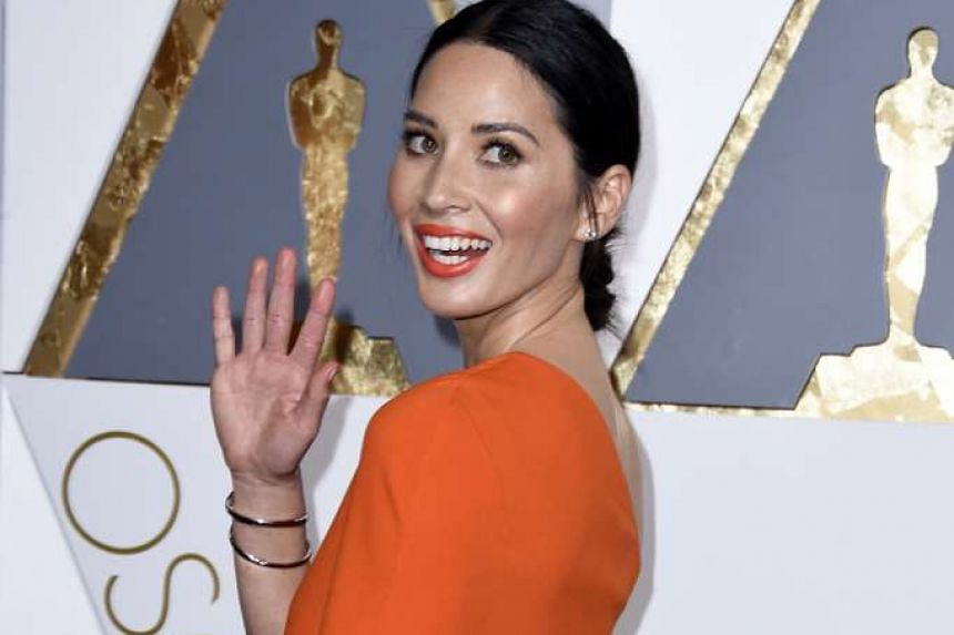 Actress Olivia Munn wore orange lipstick and a matching gown to last year's Academy Awards ceremony.