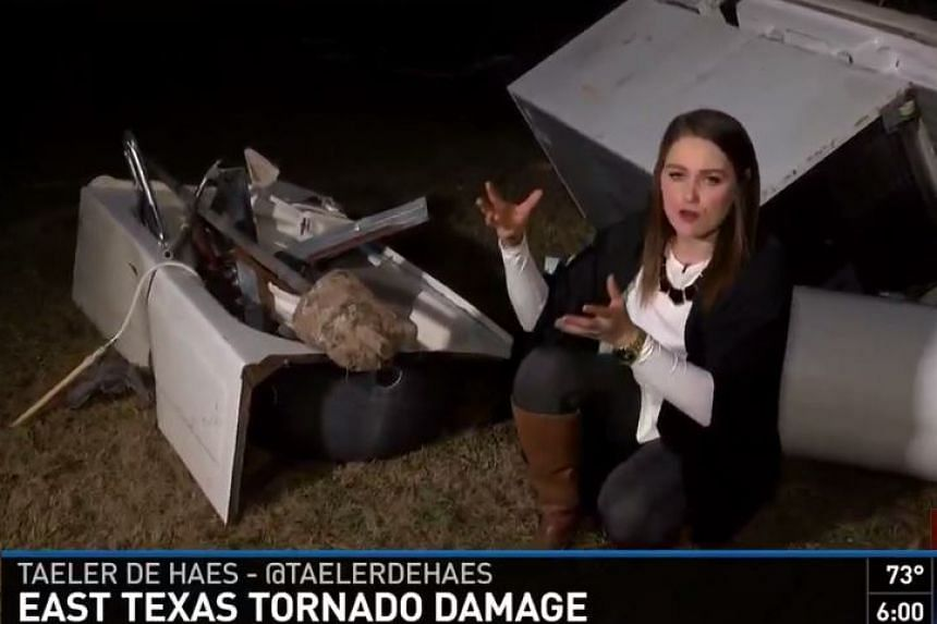 A television reporter shows viewers the bathtub that saved the lives of two people.