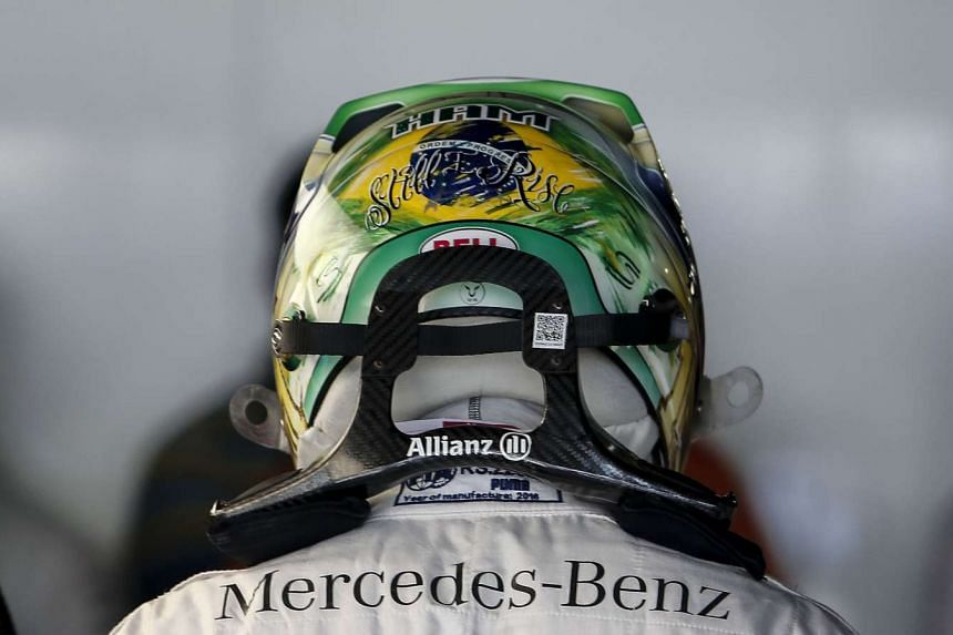 View of he back of the helmet of Mercedes AMG Petronas F1 Team's British driver Lewis Hamilton, in the pits during first practice session of the Formula One Brazilian Grand Prix , in Sao Paulo, Brazil on Nov 11, 2016.