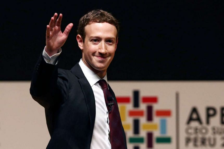 Facebook founder Mark Zuckerberg waves to the audience during an Apec meeting in Lima, Peru, Nov 19, 2016.