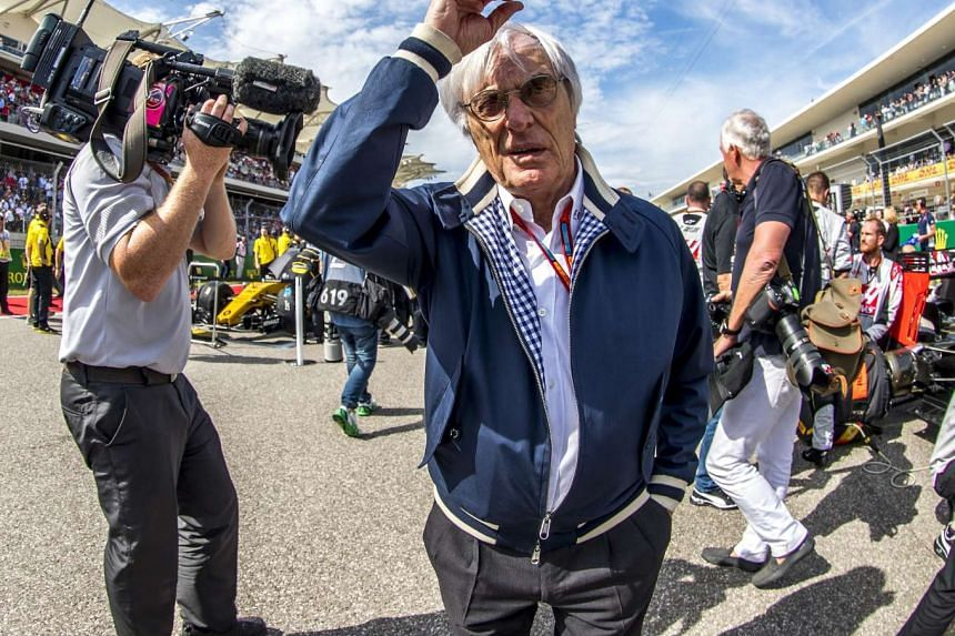 Formula One boss Bernie Ecclestone (centre) gestures while at a grid prior the United States Formula One Grand Prix 2016 at the Circuit of the Americas, in Austin, Texas, USA, on Oct 23, 2016.