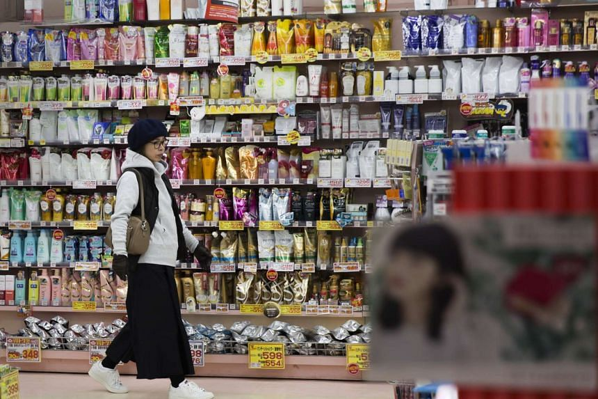 A shopper walks past personal care products displayed in a drug store in Kitakyushu, Fukuoka, Japan, on Jan 25, 2017.