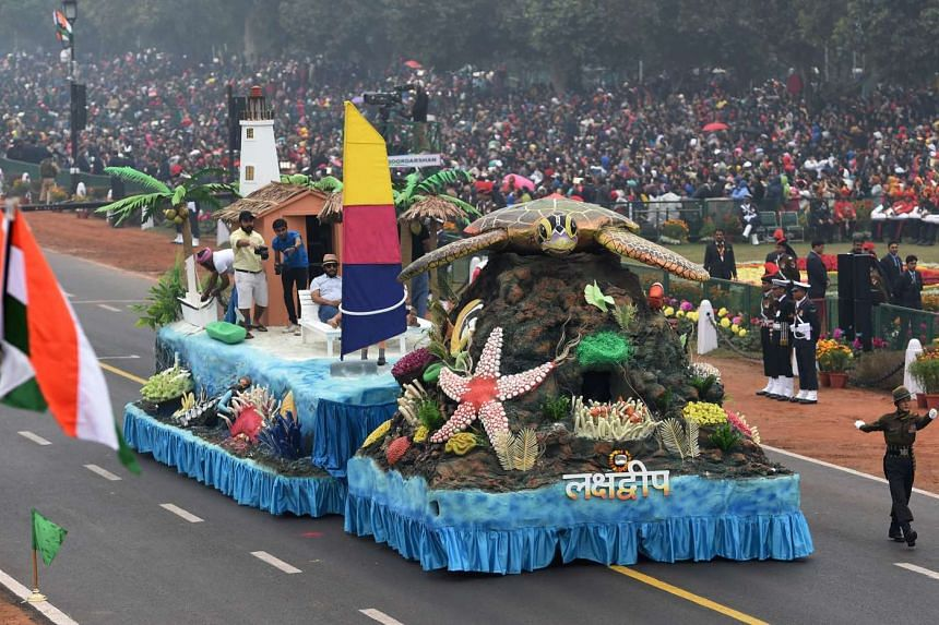 Indian performers take part in a tableaux representing the Union Territory of Laksadweep during 68th Republic Day parade in New Delhi, on Jan 26, 2017.