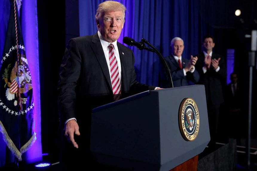 US President Donald Trump is applauded by Vice-President Mike Pence and House Speaker Paul Ryan as he arrives to speak at a congressional Republican retreat in Philadelphia on Jan 26, 2017.