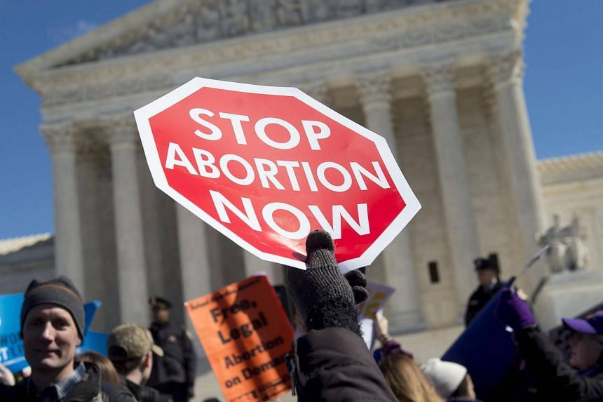 Anti-abortion activists rally outside of the Supreme Court in Washington, DC on March 2, 2016.