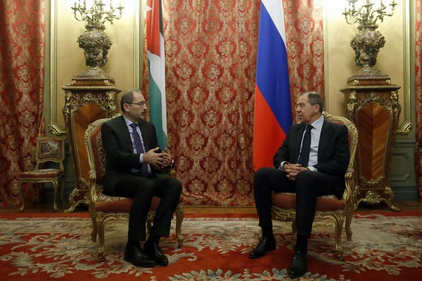 Russian Foreign Minister Sergei Lavrov (left) speaking with Jordanian Minister of Foreign Affairs Ayman Al Safadi.
