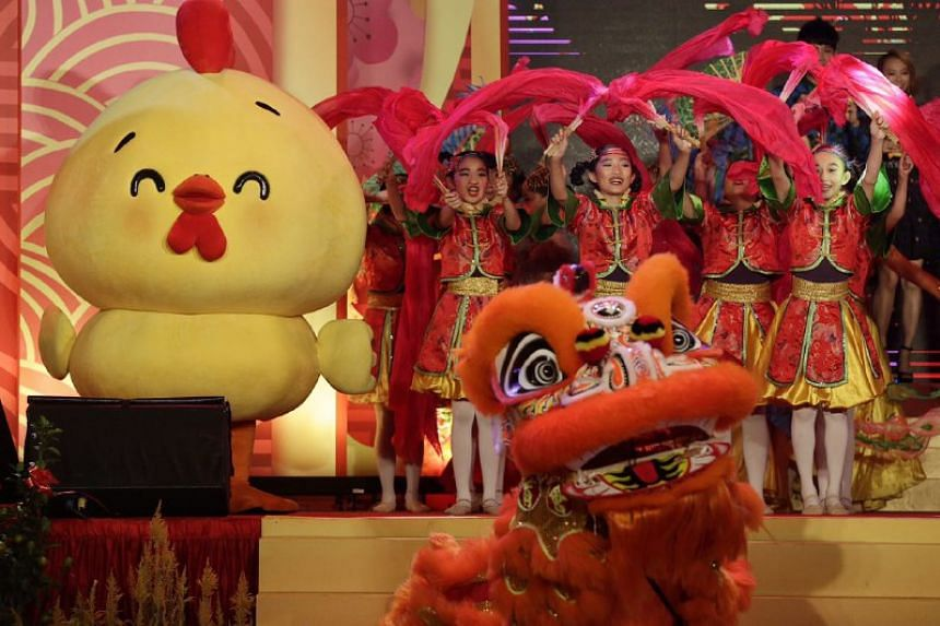 A rooster mascot on stage with performers from Dance Ensemble Singapore at the Chinatown Chinese New Year 2017 Countdown Party on Friday (Jan 27).