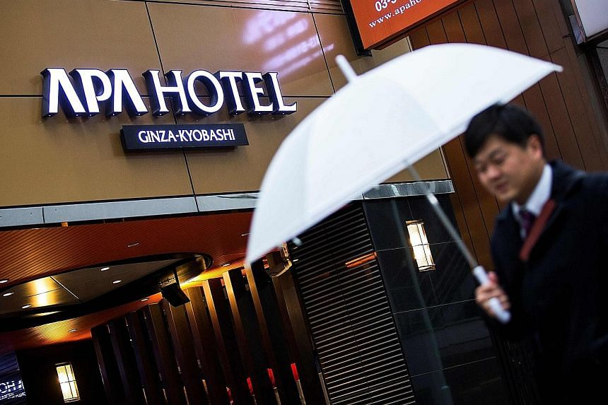 An uproar over right-wing history books which were placed in the guest rooms of Japanese hotel chain APA (above) is showing no signs of abating.