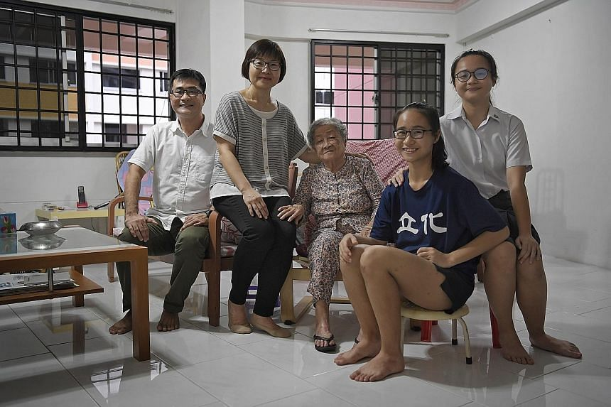 Mr Tan Chow Hua, his wife Woon Chay Lee, Mr Tan's mother Loh Khim and the couple's daughters Si Qi (right), 17, and Si Min, 15, at Madam Loh's home in Jurong West. In March, Madam Loh will move in with the family to a 3Gen flat in Boon Lay View.
