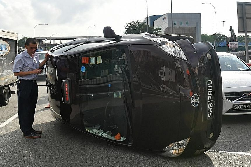 Taxi flips onto its side in accident with car, motorcycle
