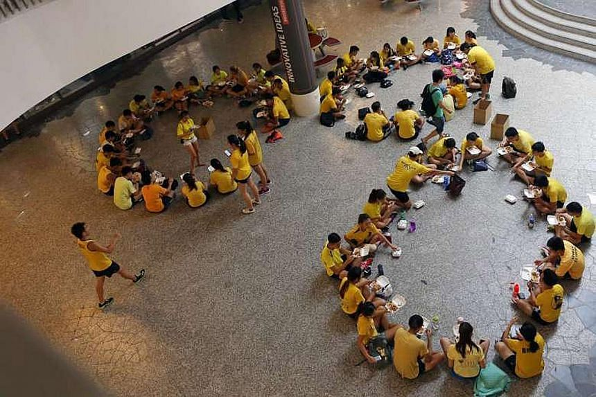NUS students participating in orientation activities, such as this one at University Town last June (above), will have to abide by a new set of rules. The change came after a furore last year over inapproriate orientation activities (below).
