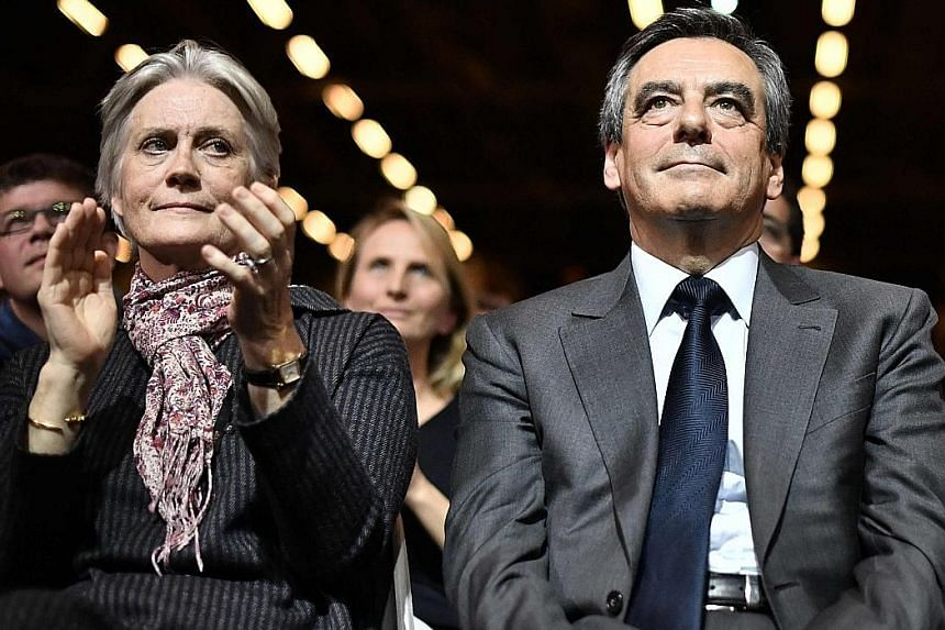 French presidential candidate Francois Fillon with his wife Penelope, who, according to a newspaper, was paid around €500,000 (S$761,000) in public money for a no-show job.