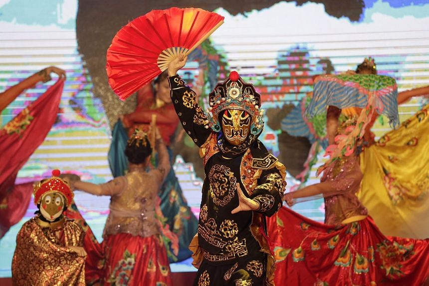 A dance and mask-changing performance by Dance Ensemble Singapore at the countdown party in Chinatown on Jan 27, 2017.