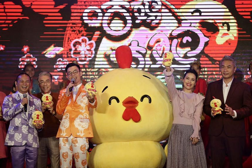 A rooster mascot joining Mediacorp artistes (L-R) Dennis Chew, Chen Shu Cheng, Mark Lee, Zoe Tay, and Tay Ping Hui in greeting the audience during the Chinatown Chinese New Year 2017 Countdown Party on Jan 27, 2017.