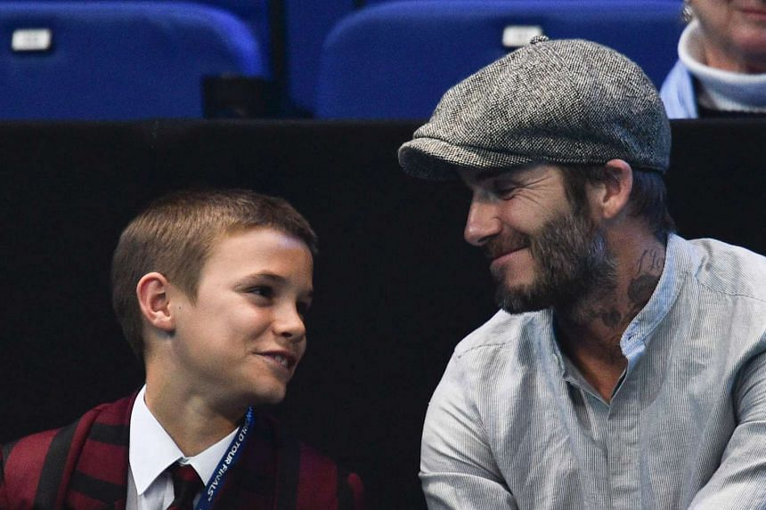 David Beckham (right) and his son Romeo applaud at a tennis tournament in London on Nov 17, 2016.