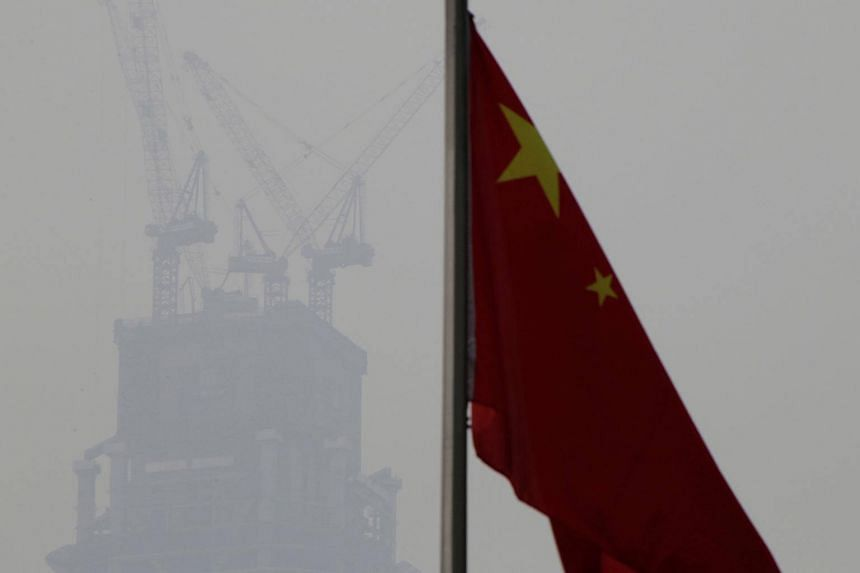 A Chinese flag is seen near a construction site in Beijing's central business area, China, on Jan 17, 2017.