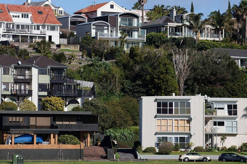 Houses stand in the suburb of Saint Heliers in Auckland, New Zealand, on July 20, 2015.