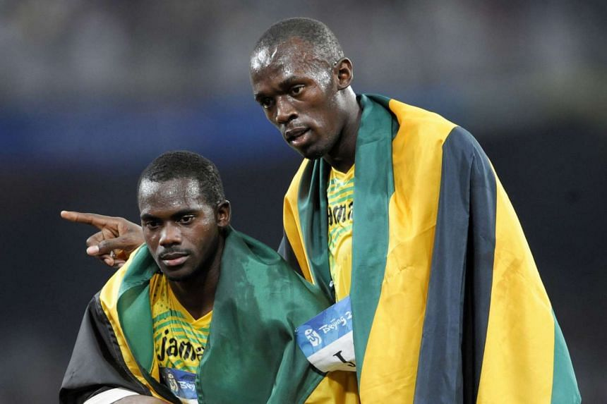 A 2008 photo shows Jamaica's Nesta Carter (left) and Usain Bolt celebrating after winning the men's 4×100m Olympic relay final in Beijing.